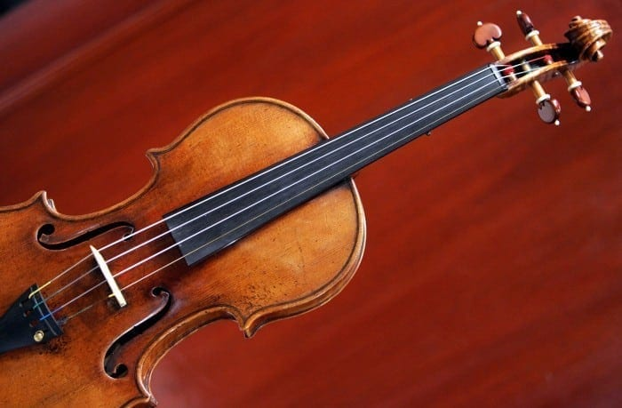"""New York, UNITED STATES: A 1729 Stradivari known as the """"Solomon, Ex-Lambert"""" is on display 27 March, 2007 at Christie's in New York. The fine musical instrument, valued at USD 1,000,000-1,500,000 will be auctioned 02 April, 2007 at Christie's. AFP PHOTO/DON EMMERT (Photo credit should read DON EMMERT/AFP/Getty Images)"""