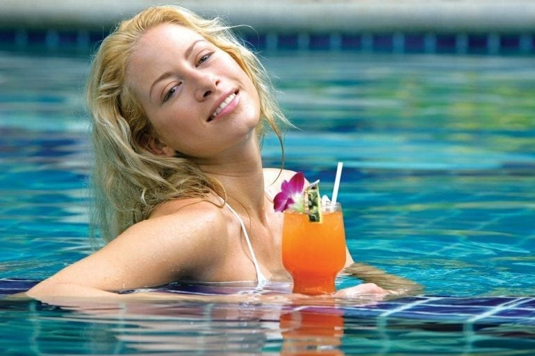 beauty blonde woman enjoying holiday in pool